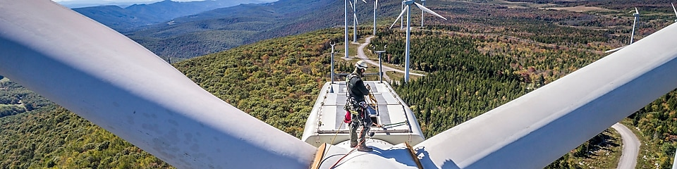 A maintenance crew member working at height at Mount Storm Wind Turbine.