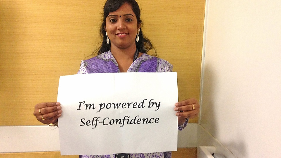 "Poorni holding ""I'm powered by self-confidence"" statement"