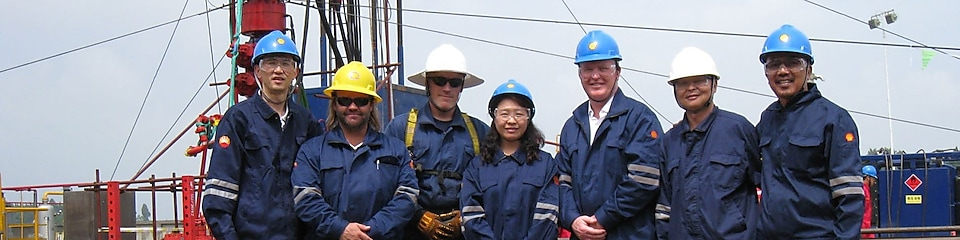 Lydia Qin on site in gas field with her colleagues