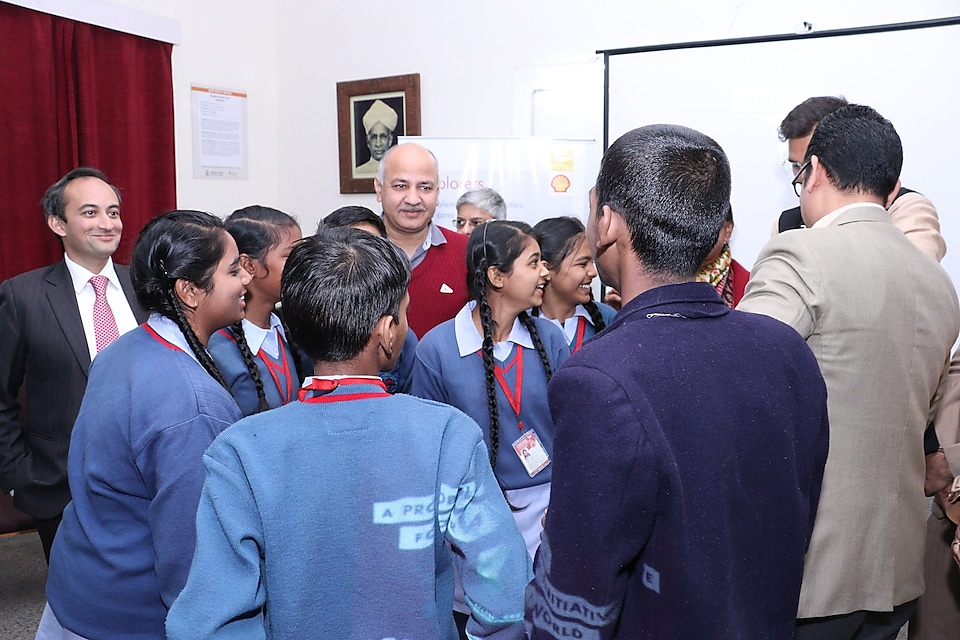 Delhi Deputy Chief Minister Manish Sisodia interacts with children about their NXplorer projects