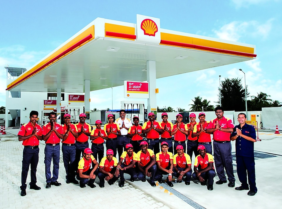 workers stand at shell petrol pump