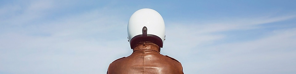 person in brown jacket and white helmet