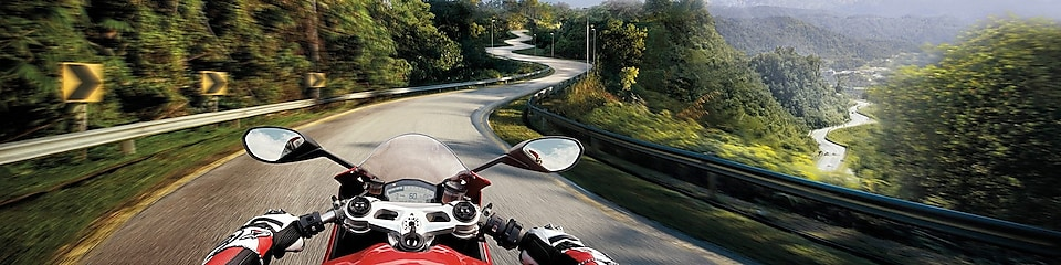 rider view of motorbike driving on mountain road